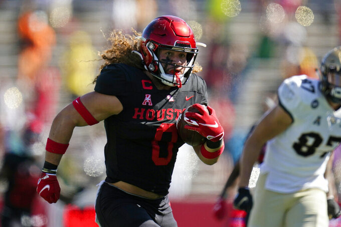 FILE - In this Oct. 31, 2020, file photo, Houston linebacker Grant Stuard (0) returns a fumble recovery for a touchdown during an NCAA football game against Central Florida in Houston. The Buccaneers finished the NFL draft by selecting Stuard with the final pick at 259th overall.(AP Photo/Matt Patterson, File)