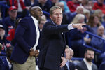 Gonzaga coach Mark Few, right, and assistant coach Roger Powell Jr. shout to players during the first half of an NCAA college basketball game against Arkansas-Pine Bluff in Spokane, Wash., Saturday, Nov. 9, 2019. (AP Photo/Young Kwak)