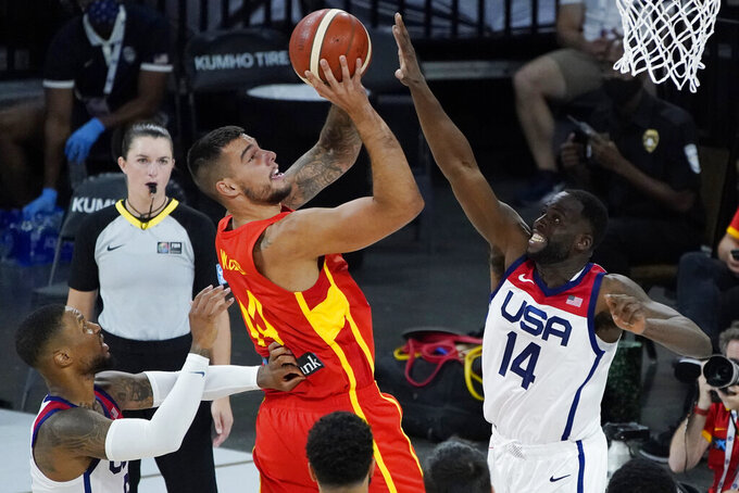 Spain's Willy Hernangomez (14) shoots against United States' Draymond Green (14) during the first half of an exhibition basketball game in preparation for the Olympics, Sunday, July 18, 2021, in Las Vegas. (AP Photo/John Locher)