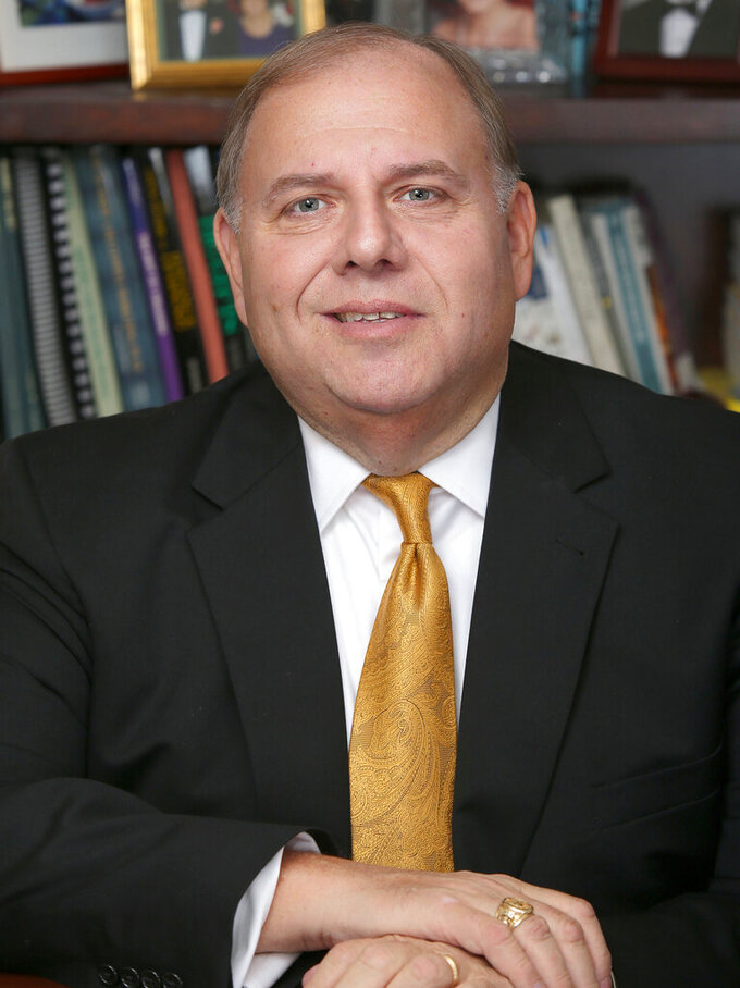 This photo provided by St. Bonaventure University shows Dr. Dennis R. DePerro, the 21st president of St. Bonaventure University, who died Monday, March 1, 2021, as a result of complications from COVID-19. He was 62. DePerro had been hospitalized since late December after testing positive for the coronavirus on Christmas Eve. (St. Bonaventure University via AP)
