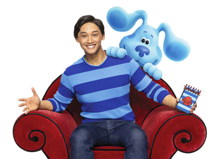 """This undated image released by Nickelodeon shows Joshua Dela Cruz who stars in the reboot of the preschool TV show """"Blue's Clues,"""" called """"Blue's Clues & You!"""" Nickelodeon is celebrating the 25th anniversary of its popular """"Blue's Clues"""" series by commissioning a movie featuring stars of the current reboot, """"Blues Clues & You."""" In the movie, Josh and Blue travel to New York City to audition for a Broadway show. (Nickelodeon via AP)"""