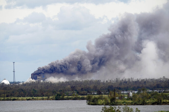 A fire at a chemical plant, BioLab Inc., that handles chlorine for swimming pools burns on Thursday, Aug. 27, 2020, in Westlake, La., in the aftermath of Hurricane Laura. (AP Photo/Gerald Herbert)