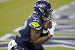 Seattle Seahawks running back Chris Carson makes a catch for a touchdown against the New England Patriots during the second half of an NFL football game, Sunday, Sept. 20, 2020, in Seattle. (AP Photo/Elaine Thompson)