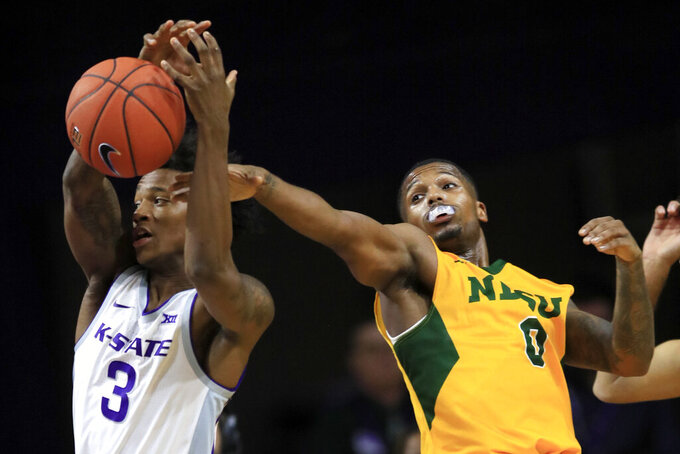 North Dakota State guard Vinnie Shahid (0) knocks the ball away from Kansas State guard Dajuan Gordon (3) during the first half of an NCAA college basketball game in Manhattan, Kan., Tuesday, Nov. 5, 2019. (AP Photo/Orlin Wagner)