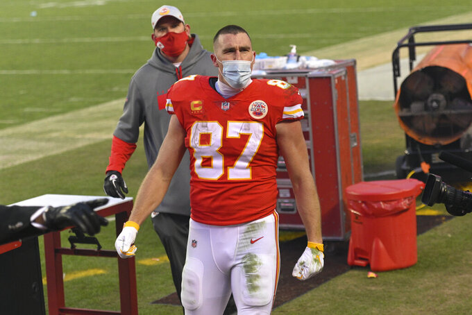 Kansas City Chiefs tight end Travis Kelce celebrates after an NFL divisional round football game against the Cleveland Browns, Sunday, Jan. 17, 2021, in Kansas City. The Chiefs won 22-17. (AP Photo/Reed Hoffmann)