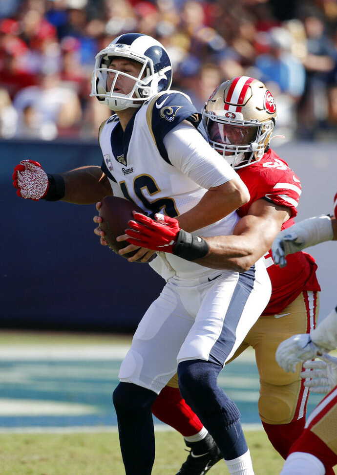 Los Angeles Rams quarterback Jared Goff (16) is sacked by San Francisco 49ers defensive end Solomon Thomas during the second half of an NFL football game Sunday, Oct. 13, 2019, in Los Angeles. (AP Photo/John Locher)