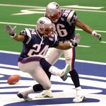 FILE - In this Feb. 3, 2002, file photo, New England Patriots cornerback Ty Law (24) celebrates his interception for a touchdown against St. Louis in the second quarter of Super Bowl XXXVI, with teammate Lawyer Milloy (36) at the Louisiana Superdome in New Orleans. Law will be inducted into the Pro Football Hall of Fame in Canton, Ohio on Aug. 3, 2019. (AP Photo/Tony Gutierrez, File)