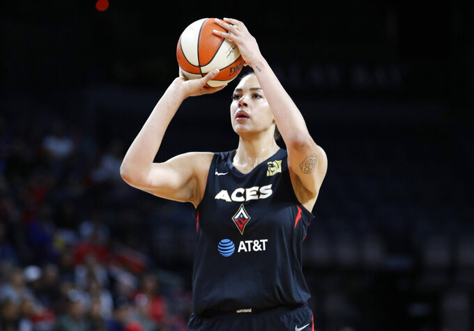 Las Vegas Aces' Liz Cambage, of Australia, plays against the Washington Mystics during the first half of Game 4 of a WNBA playoff basketball series Sept. 24, 2019, in Las Vegas. The Australian Women's National Basketball League says, Friday, Oct. 9, 2020, because of restrictions amid the COVID-19 pandemic, the eight teams will relocate to Queensland state and operate in a bio-security bubble for the duration of the regular season. (AP Photo/John Locher)