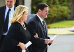 Arizona Republican Gov. Doug Ducey, right, is joined by his wife Angela as they arrive for the funeral of former Democratic U.S. Rep. Ed Pastor Friday, Dec. 7, 2018, in Phoenix. Pastor was Arizona's first Hispanic member of Congress, spending 23 years in Congress before retiring in 2014. Pastor passed away last week at the age of 75. (AP Photo/Ross D. Franklin)