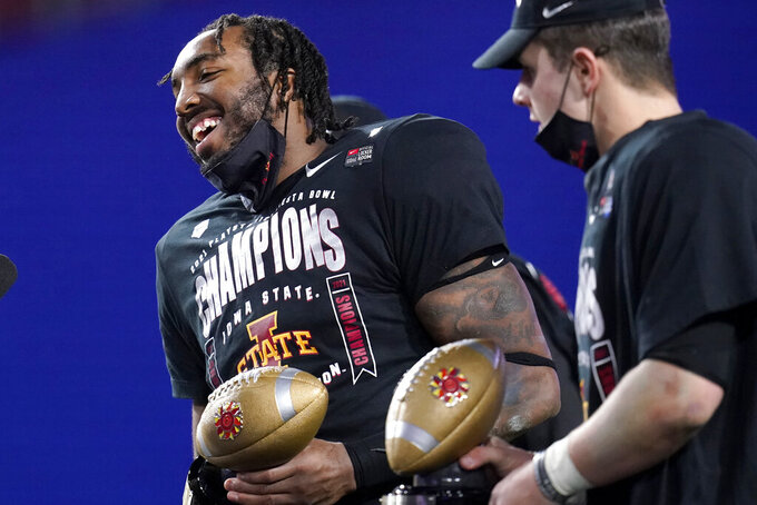 Iowa State linebacker O'Rien Vance holds the defensive player of the game award after the Fiesta Bowl NCAA college football game against Oregon, Saturday, Jan. 2, 2021, in Glendale, Ariz. Iowa State won 34-17. (AP Photo/Ross D. Franklin)