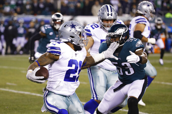 Philadelphia Eagles' Nigel Bradham (53) tries to stop Dallas Cowboys running back Ezekiel Elliott (21) during the first half of an NFL football game Sunday, Dec. 22, 2019, in Philadelphia. (AP Photo/Chris Szagola)