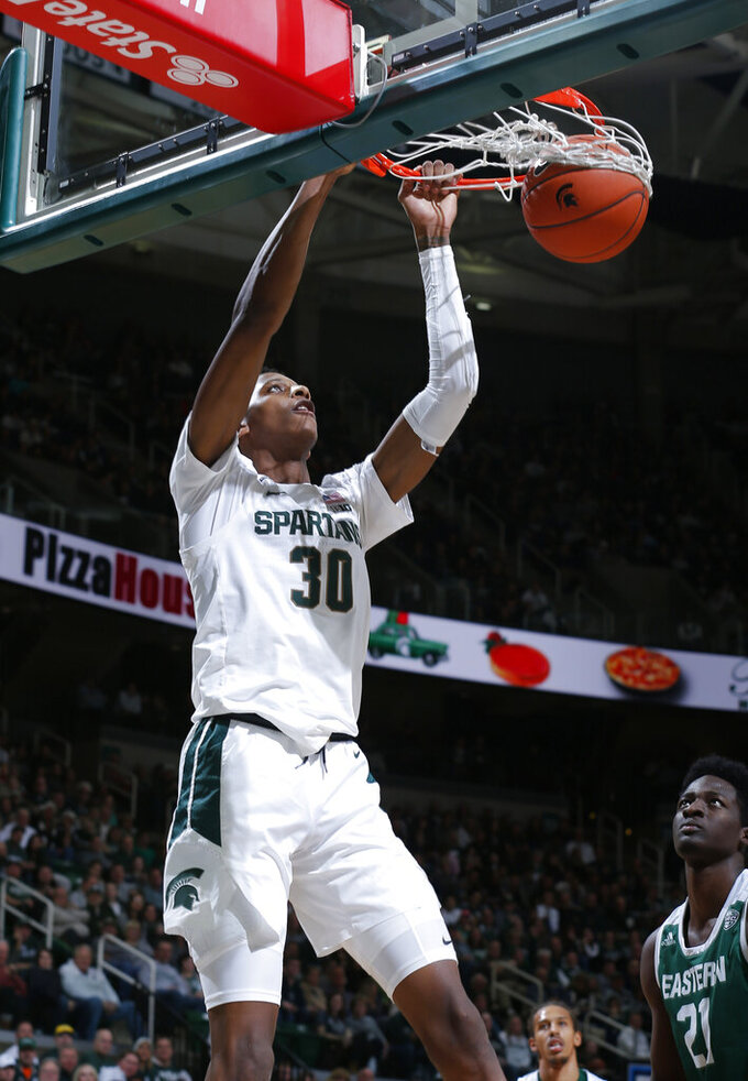 Michigan State's Marcus Bingham Jr. (30) dunks against Eastern Michigan's Boubacar Toure during the second half of an NCAA college basketball game, Saturday, Dec. 21, 2019, in East Lansing, Mich. (AP Photo/Al Goldis)
