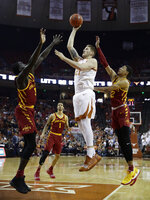 Texas forward Dylan Osetkowski (21) shoots over Iowa State guard Marial Shayok (3) during the second half of an NCAA college basketball game, Saturday, March 2, 2019, in Austin, Texas. (AP Photo/Eric Gay)