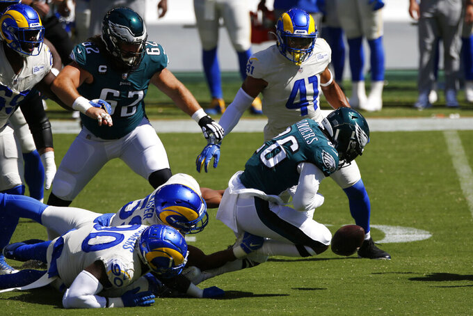 Philadelphia Eagles' Miles Sanders (26) fumbles during the first half of an NFL football game against the Los Angeles Rams, Sunday, Sept. 20, 2020, in Philadelphia. (AP Photo/Laurence Kesterson)