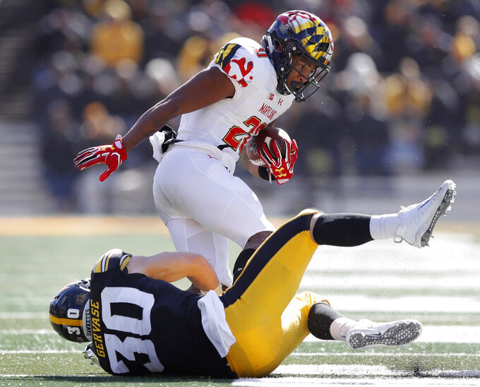 Maryland running back Javon Leake is tackled by Iowa defensive back Jake Gervase (30) during the second half of an NCAA college football game, Saturday, Oct. 20, 2018, in Iowa City, Iowa. Iowa won 23-0. (AP Photo/Charlie Neibergall)