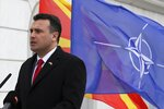 Macedonian Prime Minister Zoran Zaev delivers a speech in front of the NATO flag during a ceremony at the government building in Skopje, Tuesday, Feb. 12, 2019. Macedonian authorities began removing official signs from government buildings to prepare for the country's new name: North Macedonia. (AP Photo/Dragan Perkovksi)