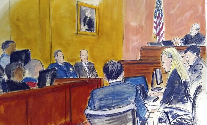 FILE - In this Monday Feb. 4, 2019 courtroom sketch, Judge Brian Cogan upper right, gives instructions to jurors in the trial of Joaquin