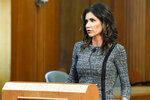 FILE - in this Oct. 13, 2020, file photo, South Dakota Governor Kristi Noem answers questions in Sioux Falls, SD. Gov. Noem is calling for the resignation of the state's attorney general who is facing misdemeanor charges for striking and killing a man with his car. Attorney General Jason Ravnsborg has indicated he will not step down while he waits for the case against him to proceed. (Erin Bormett/The Argus Leader via AP, File)