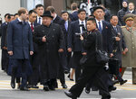 In this photo released by the press office of the administration of Primorsky Krai region, North Korea's leader Kim Jong Un, center left, surrounded by Russian and North Korea's officials arrive in Vladivostok, Russia, Wednesday, April 24, 2019. North Korean leader Kim Jong Un arrived in Russia on Wednesday morning for his much-anticipated summit with Russian President Vladimir Putin in the Pacific port city of Vladivostok. (Igor Novikov/Press Office of the Primorye Territory Administration via AP)
