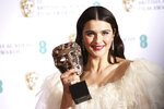 Actress Rachel Weisz poses for photographers backstage with her Best Supporting Actress award for her role in the film 'The Favourite' at the BAFTA awards in London, Sunday, Feb. 10, 2019. (Photo by Joel C Ryan/Invision/AP)