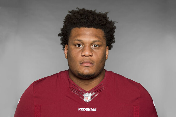 FILE - This is a 2019 file photo showing Ereck Flowers of the Washington Redskins NFL football team. Offensive lineman Ereck Flowers has agreed to terms on a $30 million, three-year contract with the Miami Dolphins, Monday, March 16, 2020. The deal was confirmed by Flowers' agent, Drew Rosenhaus, who said $19.95 million is guaranteed.(AP Photo/File)