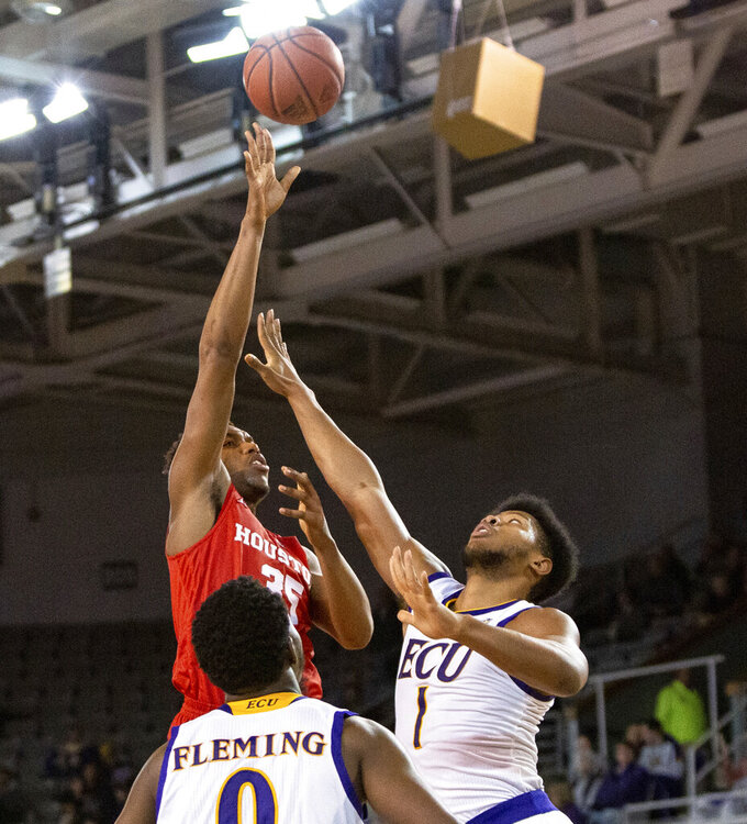 Houston's Fabian White Jr. (35) attempts a shot over East Carolina's Jayden Gardner (1) during the second half of an NCAA college basketball game in Greenville, N.C., Wednesday, Feb. 27, 2019. (AP Photo/Ben McKeown)