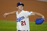 Los Angeles Dodgers starting pitcher Walker Buehler throws against the Atlanta Braves during the first inning in Game 1 of a baseball National League Championship Series Monday, Oct. 12, 2020, in Arlington, Texas. (AP Photo/Tony Gutierrez)
