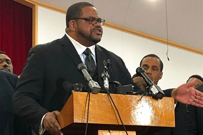Pastor Kyev Tatum speaks at a news conference at a church to a group of community leaders on Wednesday, Oct. 16, 2019, in Fort Worth, Texas, who are calling for a plan overseen by a federal judge to reform the Fort Worth Police Department. This comes after the fatal shooting of a 28-year-old woman in her home over the weekend in Fort Worth. (AP Photo/Jamie Stengle)