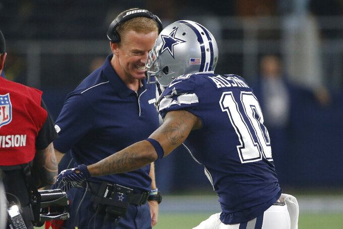 Dallas Cowboys head coach Jason Garrett, left, greets wide receiver Tavon Austin (10)  who returns to the sideline following a touchdown in the first half of an NFL football game against the Los Angeles Rams in Arlington, Texas, Sunday, Dec. 15, 2019. (AP Photo/Ron Jenkins)
