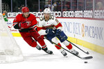 Florida Panthers' Carter Verhaeghe (23) is chased by Carolina Hurricanes' Brett Pesce (22) during the third period of an NHL hockey game in Raleigh, N.C., Tuesday, April 6, 2021. (AP Photo/Karl B DeBlaker)