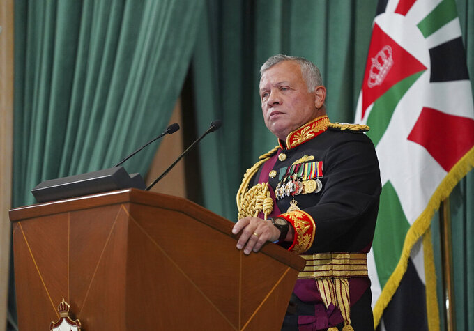 "FILE - In this Dec. 10, 2020  photo released by the Royal Hashemite Court, Jordan's King Abdullah II gives a speech during the inauguration of the 19th Parliament's non-ordinary session, in Amman Jordan.  Jordan's army chief of staff says the half-brother of King Abdullah II was asked to ""stop some movements and activities that are being used to target Jordan's security and stability."" The army chief of staff denied reports Saturday, April 3, 2021, that Prince Hamzah was arrested. He said an investigation is still ongoing and its results will be made public ""in a transparent and clear form.""   (Yousef Allan/The Royal Hashemite Court via AP, File)"