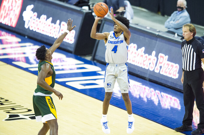Creighton's Shereef Mitchell (4) scores against North Dakota State during the second half of an NCAA college basketball game in Omaha, Neb., Sunday, Nov. 29, 2020. (AP Photo/Kayla Wolf)