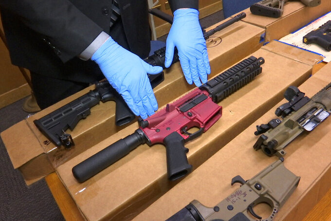 """FILE - In this file photo taken Wednesday, Nov. 27, 2019, is Sgt. Matthew Elseth with """"ghost guns"""" on display at the headquarters of the San Francisco Police Department in San Francisco. A U.S. judge says she won't block a Nevada law banning the manufacture and possession of so-called """"ghost guns"""" that don't have serial numbers. U.S. District Judge Miranda Du in Reno refused on Monday, July 26, 2021, to issue an injunction preventing enforcement of the law signed in June by Gov. Steve Sisolak. It goes into effect Jan. 1, 2022. The judge says she's not convinced the measure violates Second Amendment gun rights and a Fifth Amendment ban on government seizure of property. (AP Photo/Haven Daley,File)"""