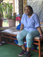 Deloris Knight of Detroit, Mich., sits on her front porch, Wednesday, July 17, 2019, as she prepares for the heat wave that will descend upon Detroit and a wide section of the Midwest. Knight said she will keep the heat out of her Eastside Detroit home by keeping her doors and curtains closed while running the small window air conditioner in the living room.