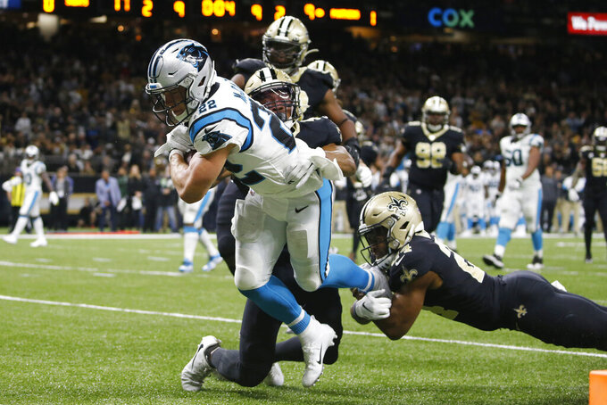 Carolina Panthers running back Christian McCaffrey (22) is tackled short of the endzone by New Orleans Saints fullback Zach Line (42) and strong safety Vonn Bell (24), during the first half at an NFL football game, Sunday, Nov. 24, 2019, in New Orleans. (AP Photo/Butch Dill)
