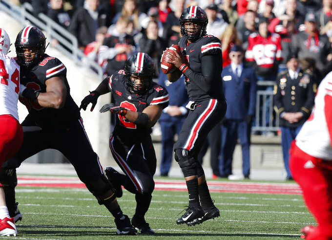 Ohio State quarterback Dwayne Haskins, right, drops back to pass against Nebraska during the second half of an NCAA college football game Saturday, Nov. 3, 2018, in Columbus, Ohio. Ohio State beat Nebraska 36-31. (AP Photo/Jay LaPrete)