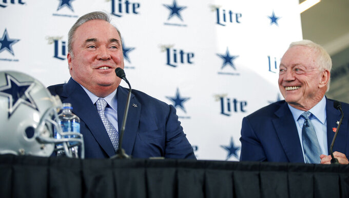 New Dallas Cowboys head coach Mike McCarthy, left, is introduced by team owner Jerry Jones, right, during a press conference at the Dallas Cowboys headquarters Wednesday, Jan. 8, 2020, in Frisco, Texas. (AP Photo/Brandon Wade)