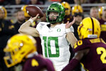 Oregon quarterback Justin Herbert (10) throws a pass during the first half of the team's NCAA college football game against Arizona State, Saturday, Nov. 23, 2019, in Tempe, Ariz. (AP Photo/Matt York)