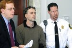 In this Jan. 29, 2009, photo, Sean Murphy, center, alleged mastermind behind a $2 million jewelry heist from the E.A. Dion jewelry manufacturing company in 2008, in Attleboro, Mass., is arraigned in Attleboro District Court. At left is his attorney Neal Steingold and at right is court officer Howie Werman. In a February 2020 letter to The Associated Press, the career criminal said he is hoping to catch a break on his prison sentence from burglarizing a Brink's warehouse in Columbus, Ohio, during which he accidentally set millions of dollars on fire. (Mark Stockwell/The Sun Chronicle via AP)