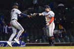 Minnesota Twins' Nick Gordon (1) and Josh Donaldson celebrate the team's 9-5 win over the Chicago Cubs after a baseball game Tuesday, Sept. 21, 2021, in Chicago. (AP Photo/Charles Rex Arbogast)