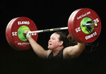 FILE - In this April 9, 2018, file photo, New Zealand's Laurel Hubbard lifts in the snatch of the women's 90kg weightlifting final at the 2018 Commonwealth Games on the Gold Coast, Australia. Hubbard, a transgender woman, is competing in weightlifting for New Zealand (AP Photo/Mark Schiefelbein, File)