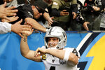 Oakland Raiders quarterback Derek Carr celebrates after scoring during the first half of an NFL football game against the Los Angeles Chargers Sunday, Dec. 22, 2019, in Carson, Calif. (AP Photo/Marcio Jose Sanchez)