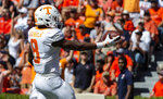 Tennessee running back Ty Chandler (8) runs in a 42-yard pass for a touchdown against Auburn during the first half of an NCAA college football game, Saturday, Oct. 13, 2018, in Auburn, Ala. (AP Photo/Vasha Hunt)
