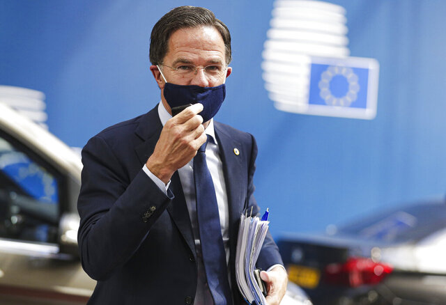 Dutch Prime Minister Mark Rutte arrives for an EU summit in Brussels, Monday, July 20, 2020. Leaders from 27 European Union nations stretch their meeting into a fourth day on Monday to assess an overall budget and recovery package spread over seven years. (Stephanie Lecocq, Pool Photo via AP)