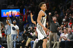 Fans celebrate after Atlanta Hawks guard Trae Young made a basket near the end of an NBA basketball game against the Philadelphia 76ers, Saturday, March 23, 2019, in Atlanta. (AP Photo/John Amis)