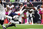 Atlanta Falcons wide receiver Mohamed Sanu (12) scores a touchdown past Houston Texans cornerback Lonnie Johnson (32) during the first half of an NFL football game Sunday, Oct. 6, 2019, in Houston. (AP Photo/Eric Christian Smith)
