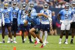 Tennessee Titans cornerback Caleb Farley (3) runs a drill during NFL football training camp Monday, Aug. 16, 2021, in Nashville, Tenn. (AP Photo/Mark Humphrey)