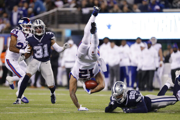 New York Giants wide receiver Cody Latimer (12) is upended by Dallas Cowboys defensive back C.J. Goodwin (29) during the fourth quarter of an NFL football game, Monday, Nov. 4, 2019, in East Rutherford, N.J. (AP Photo/Adam Hunger)
