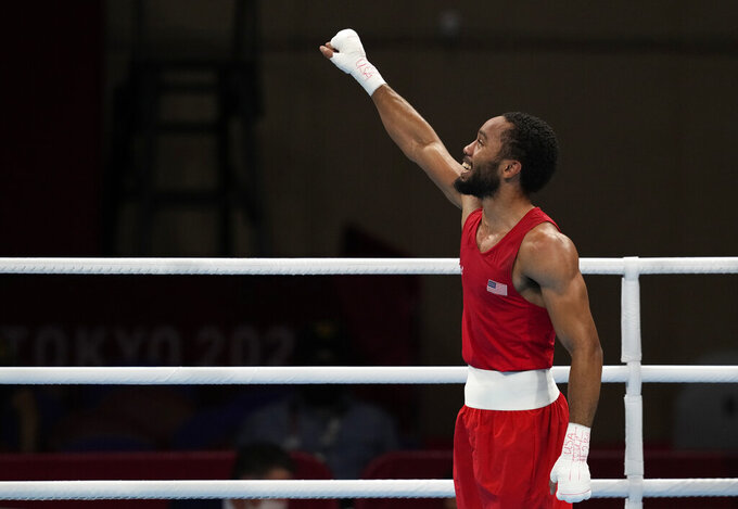 The United States' Duke Ragan celebrates after winning his fight against Ghana's Samuel Takyi for their men's featherweight 57-kg semifinal boxing match at the 2020 Summer Olympics, Tuesday, Aug. 3, 2021, in Tokyo, Japan. (AP Photo/Themba Hadebe)