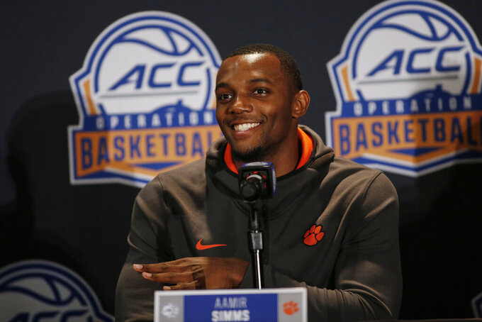 Clemson player Aamir Simms answers a question during the Atlantic Coast Conference NCAA college basketball media day in Charlotte, N.C., Tuesday, Oct. 8, 2019. (AP Photo/Nell Redmond)